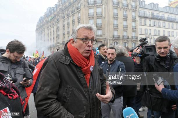 French Communist Party General Secretary Pierre Laurent speaks to the press during a demonstration in front of the Gare de lEst railway station in...