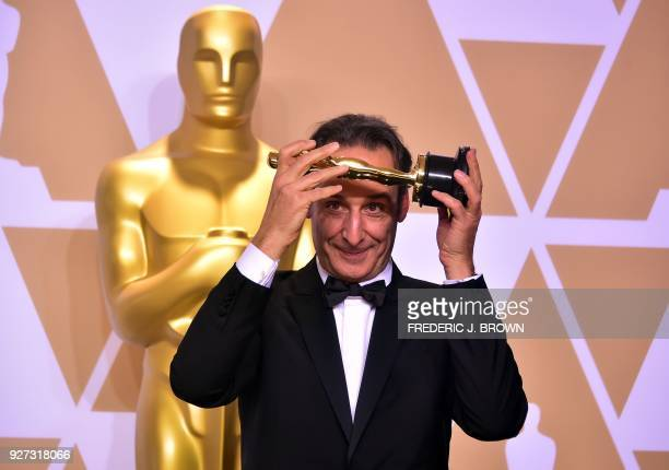 French composer Alexandre Desplat poses in the press room with the Oscar for Best Original Score for 'The Shape of Water' during the 90th Annual...