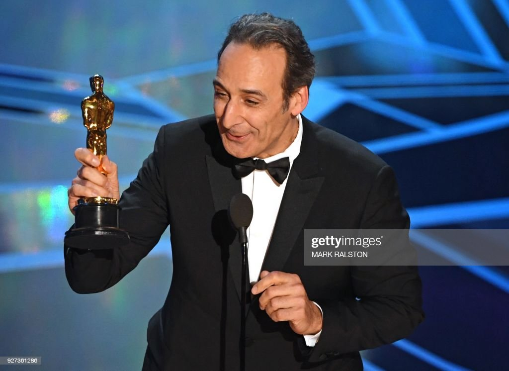 French composer Alexandre Desplat smiles after he won the Oscar for Best Original Score for 'The Shape of Water' during the 90th Annual Academy Awards show on March 4, 2018 in Hollywood, California. / AFP PHOTO / Mark Ralston