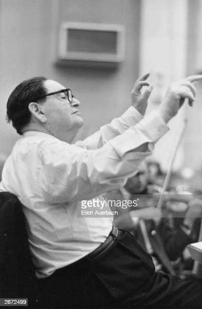 French composer and pianist Darius Milhaud conducting at BBC's Maida Vale studios, London.