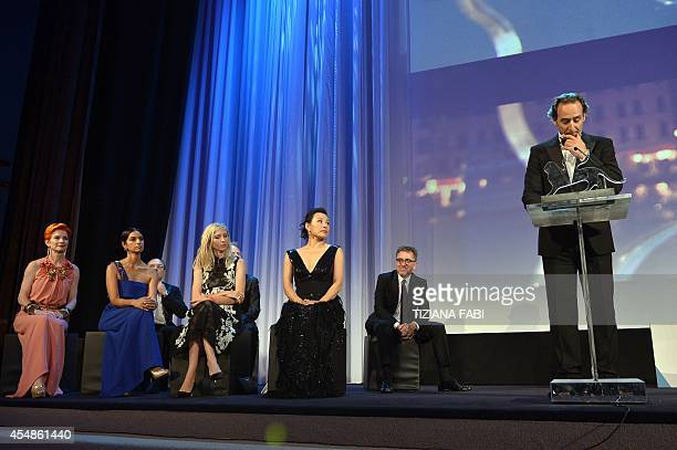 French composer and president of the jury Alexandre Desplat delivers a speech next to jury members British costume designer Sandy Powell US author...