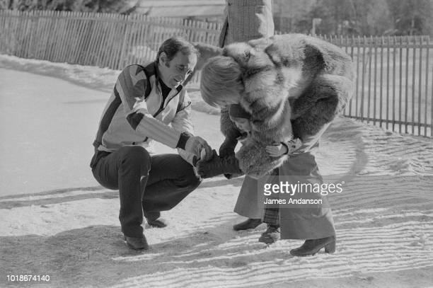 French composer Charles Aznavour with his daughter Katia and his third wife Swede Ulla Thorsell in Crans sur Sierre Switzerland 13th January 1973