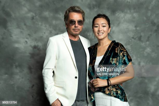 TOPSHOT French composer JeanMichel Jarre and actress Gong Li pose during the opening night of the 2018 COLCOA French Film Festival April 23 2018 at...