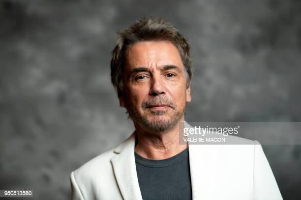 TOPSHOT French composer JeanMichel Jarre poses during the opening night of the 2018 COLCOA French Film Festival April 23 2018 at the Directors Guild...