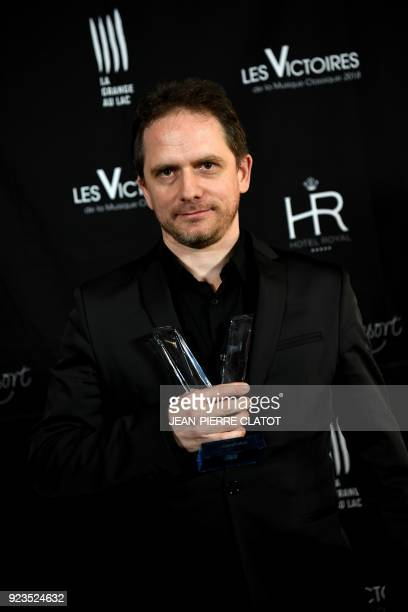 French composer Karol Beffa poses after receiving an award at the 'Victoire de la musique classique' award ceremony at The Grange au Lac Auditorium...