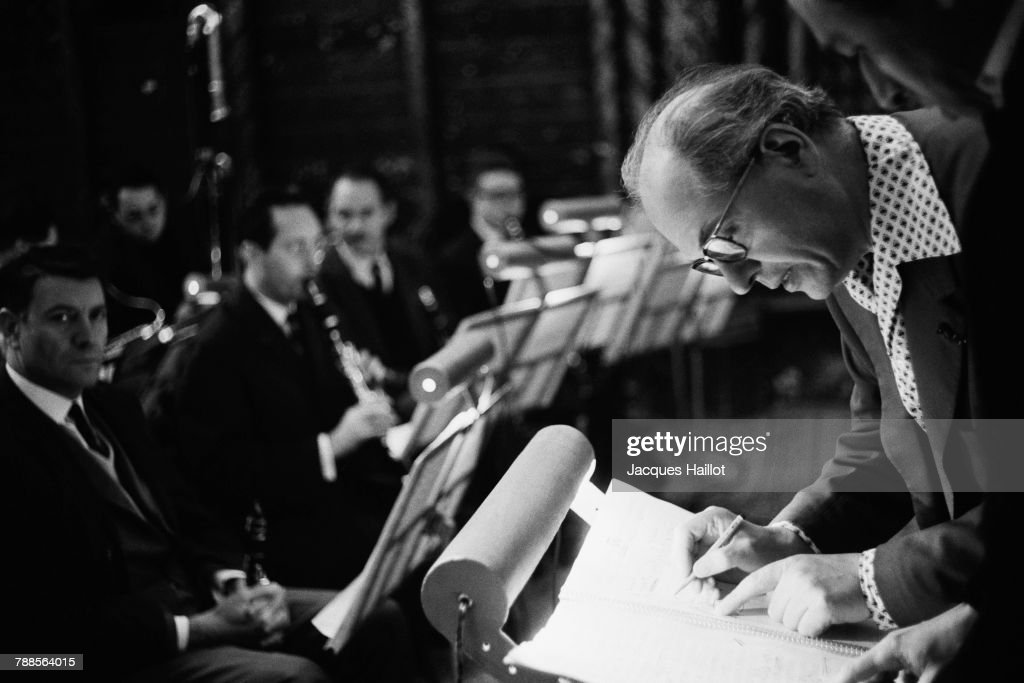 French composer Oliver Messiaen rehearsing with musicians at the Ste.-Chapelle.