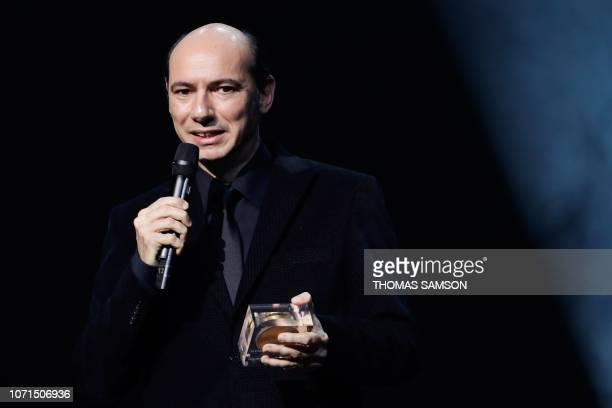 French composer Philippe Rombi celebrates after receiving the 'Best music for images' award during the SACEM Grand Prix awards ceremony on December...