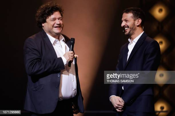 French composer Philippe Schoeller celebrates with French humorist and host Vincent Dedienne after receiving the 'Symphony music' award during the...