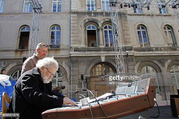 French composer Pierre Henry adjusts his music stand 11 July 2007 at the SaintJoseph school in Avignon southern France during the 61st edition of the...