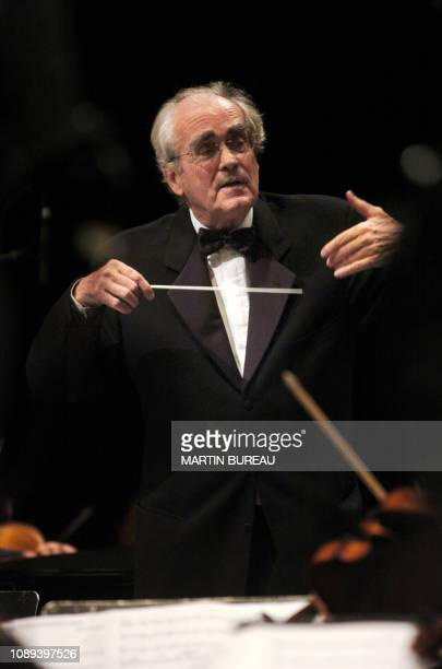 French composer singer and conductor Michel Legrand conducts the orchestra of the Camerata de Bourgogne on October 23 2004 in Auxerre during the 5th...