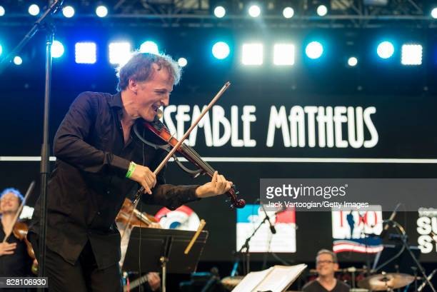 French conductor and musician JeanChristophe Spinosi plays violin as he leads the Ensemble Matheus during a performance at Central Park SummerStage...