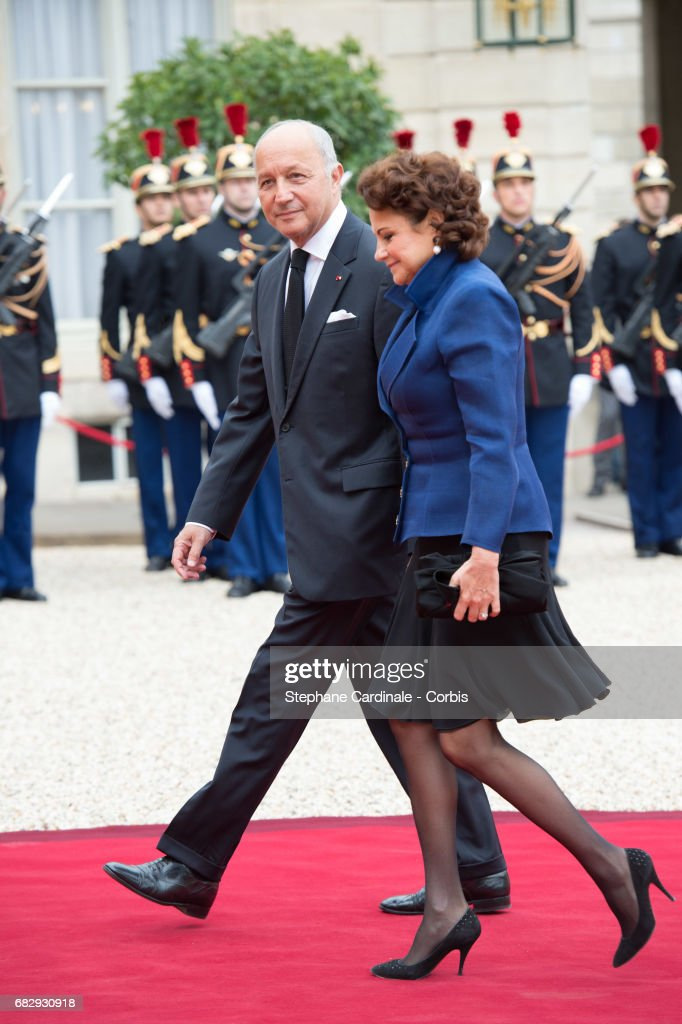 French Constitutional Council President Laurent Fabius (L) and his wife Francoise Castro arrive at the Elysee Palace prior to the handover ceremony for New French President Emmanuel Macron at Elysee Palace on May 14, 2017 in Paris, France. Emmanuel Macron was elected President of the French Republic on May 07, 2017 with 66,1 % of the votes cast.