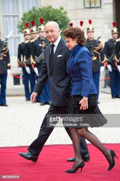 French Constitutional Council President Laurent Fabius and his wife Francoise Castro arrive at the Elysee Palace prior to the handover ceremony for...