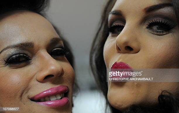 French contestants Stella Rocha and Estelle Roedrer pose backstage ahead of the Miss International Queen 2010 beauty pageant in southeastern...