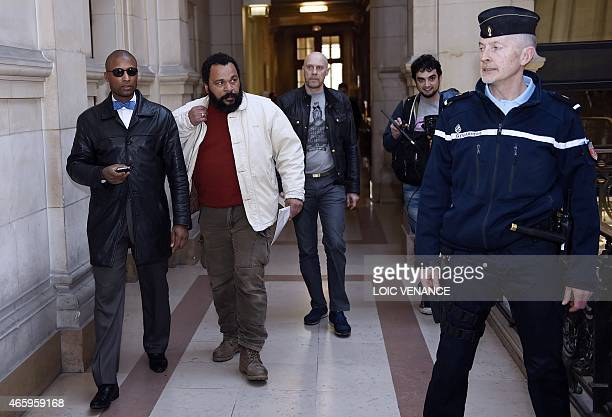 French controversial comic Dieudonne M'bala M'bala and French farright writer Alain Soral arrive at the Paris courthouse on March 12 for Soral's...