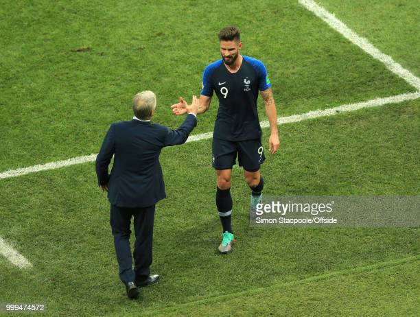 French cooach Didier Deschamps shakes hands with Olivier Giroud of France as he is substituted during the 2018 FIFA World Cup Russia Final between...