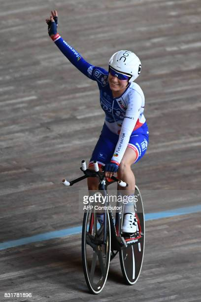 French Coralie Demay gestures after winning the Woman's individual Elite of the French championships ahead on August 15 2017 at the Hyeres' velodrome...