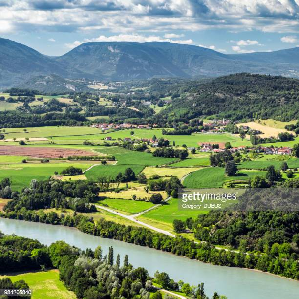 french countryside landscape view of small villages from southern bugey alps mountains in summer with rhone river in auvergne-rhone-alpes region - rhone stock pictures, royalty-free photos & images