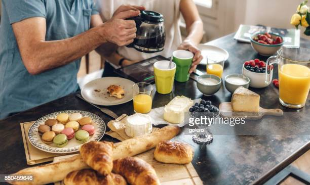french couple at breakfast table