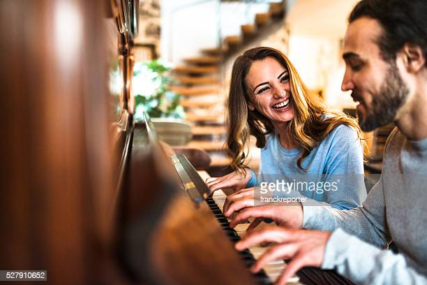 french couple playing the piano in a parisen house