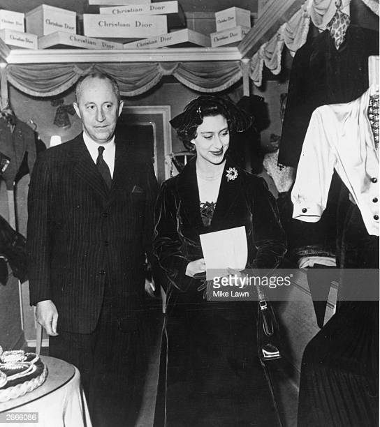French couturier Christian Dior shows Princess Margaret round his Paris showroom.