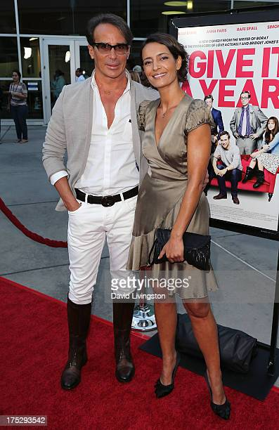 French couturier Lloyd Klein and Bahia Haifi attend a screening of Magnolia Pictures' I Give It a Year at ArcLight Hollywood on August 1 2013 in...