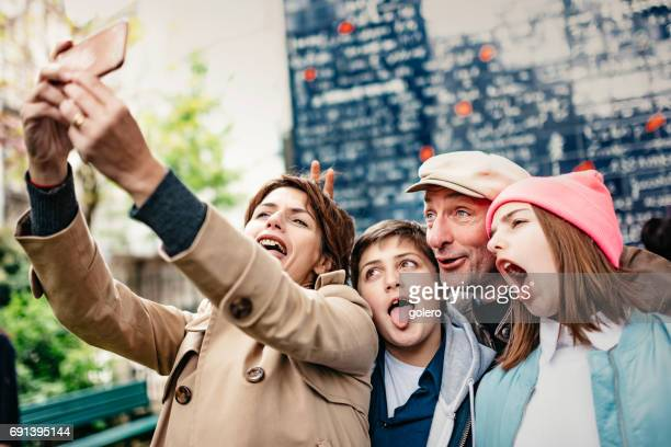 french crazy family taking selfie outdoors