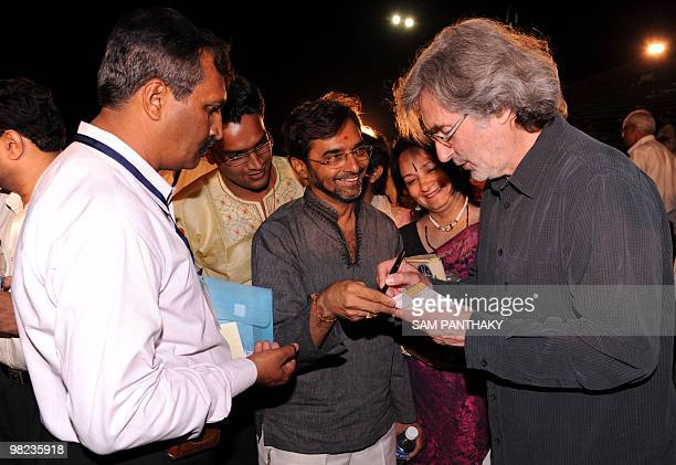 French creative director Yves Pepin signs autographs after the inaugural ceremony a perfomance of The SatChitAnand Water Show at The Bochasanwasi...