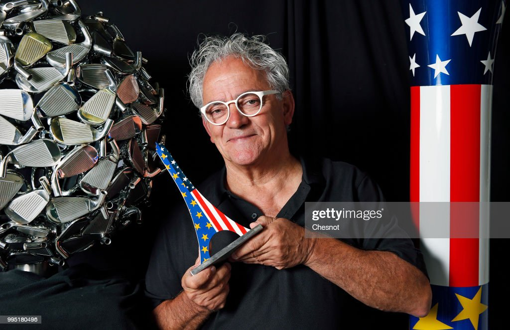 French creator, sculptor and artist, Hubert Prive poses in his workshop with his creations, an Eiffel Tower and a giant tee decorated in the colours of the United States and European flag on July 10, 2018 in Verneuil-sur-Avre, France. Hubert Prive is a visual artist and a designer, his inspiration comes from the world of golf, a sport he has practised for over twenty five years. Since 2008, more than 300 creations have come from his hands and creative spirit. This year, Hubert Prive was inspired by the Ryder Cup 2018, the global golf tournament between Europe and the United States which will take place from 28 to 30 September 2018 in France at Golf de Guyancourt near Paris.