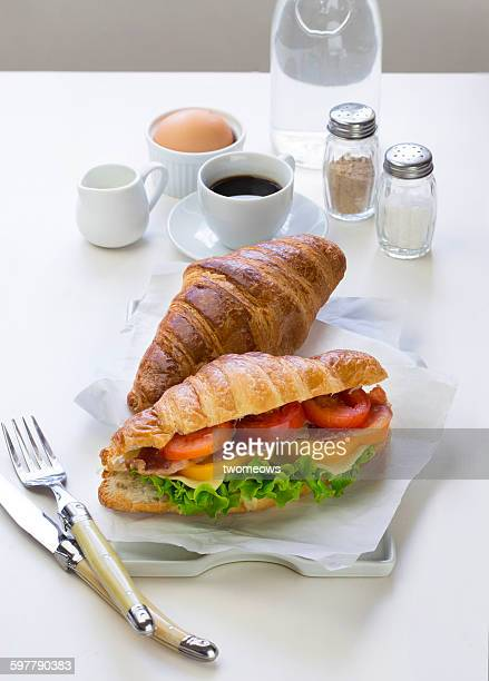 French croissant sandwich on white table top