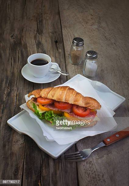 French croissant sandwich on wooden table top