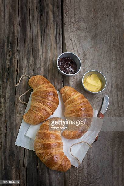 French Croissants on wooden background