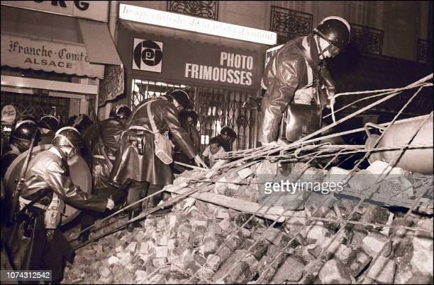 French CRS Police forces climb a barricade of bricks during the 10-11 May 1968 night of riots in the Latin Quarter in Paris during the May-June 1968...