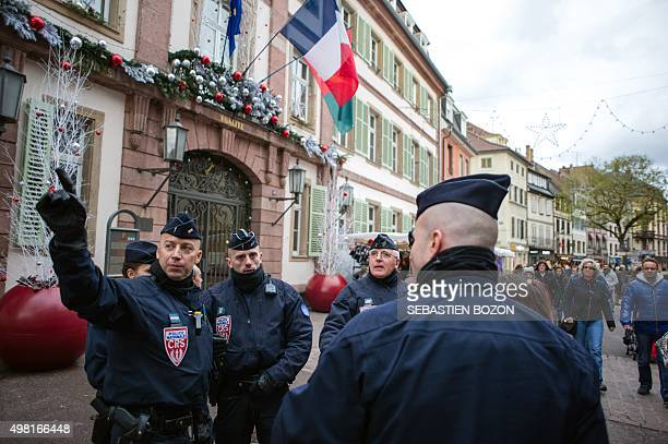 French CRS police officers talk as they patrol on November 21 2015 at the Colmar Christmas market French lawmakers gave nearunanimous backing on...