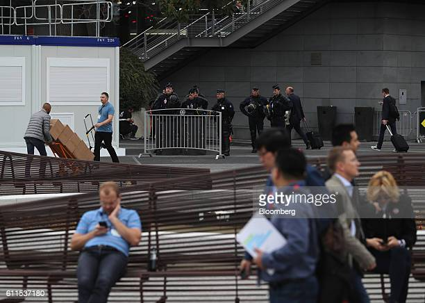 French CRS riot police stand guard at Porte de Versailles exhibition center during the second press day of the Paris Motor Show in Paris, France, on...