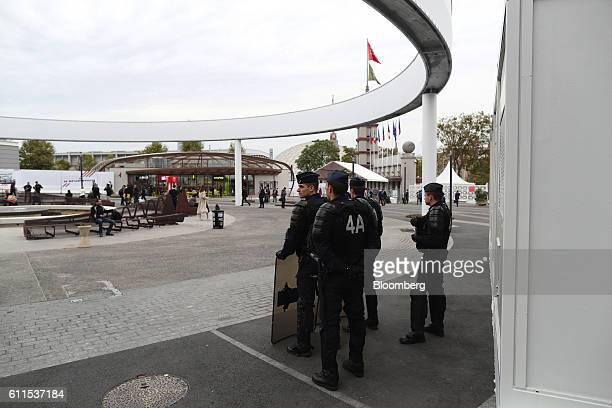 French CRS riot police stand near the entrance of Porte de Versailles exhibition center during the second press day of the Paris Motor Show in Paris,...