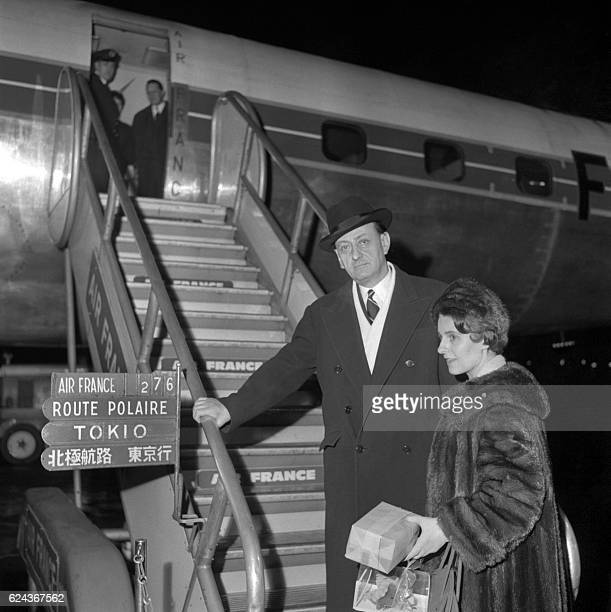 French Culture Minister André Malraux and his wife MarieMadeleine Lioux pictured on February 20 1960 at Orly airport before boarding an Air France...