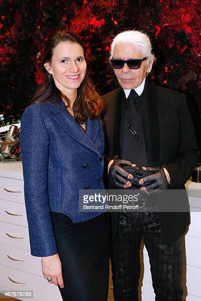 French Culture Minister Aurelie Filippetti and Fashion designer Karl Lagerfeld at the showroom of 'Maison Lemarie' as they visit 'Les Ateliers d'Art'...