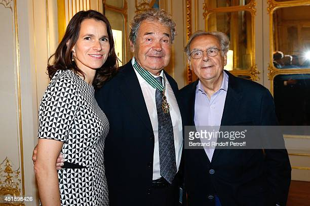 French Culture Minister Aurelie Filippetti Pierre perret and journalist Bernard Pivot attend singer Pierre Perret receives the insignia of Commander...