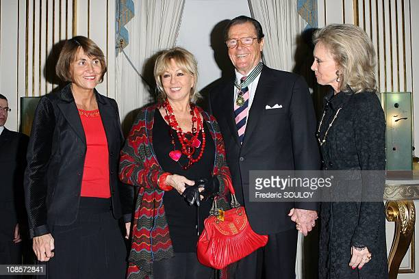 French Culture Minister Christine Albanel Mylene Demongeot Sir Roger Moore and his wife Kristina Tholstrup in Paris France on October 28 2008