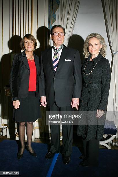 French Culture Minister Christine Albanel, Sir Roger Moore and his wife Kristina Tholstrup in Paris, France on October 28, 2008.