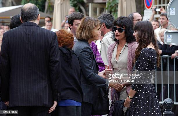 French Culture Minister Christinre Albanel comforts Nathalie Serrault and Gwendoline Courreges daughter and granddaughter of French actor Michel...