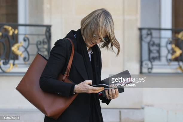 French Culture Minister Francoise Nyssen checks her mobile phone as she leaves the Elysee palace following the weekly cabinet meeting on January 17...