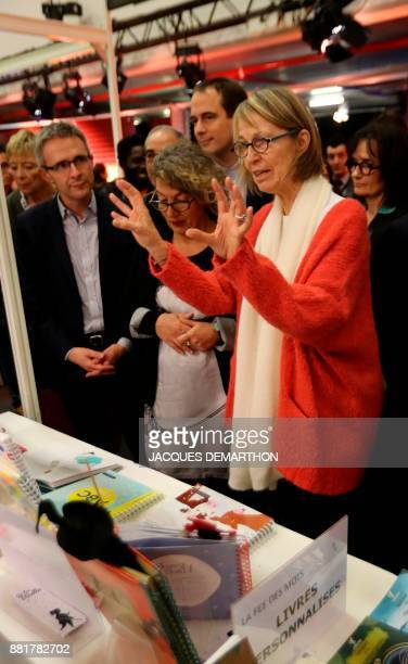 French Culture Minister Francoise Nyssen gestures as she attends the inauguration of the Montreuil Youth Book Fair at Montreuil on the outskirts of...