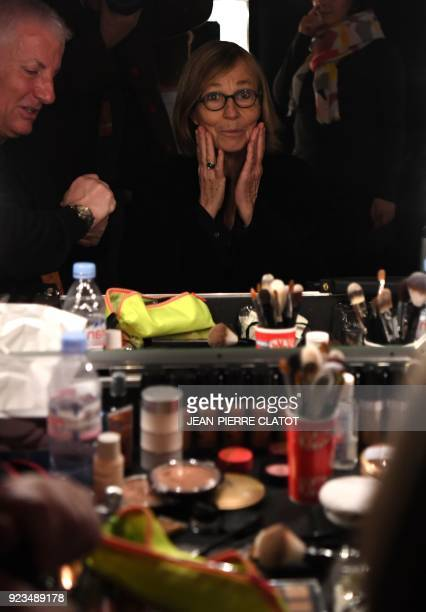 French Culture Minister Françoise Nyssen is reflected in a mirror as she is made up ahead of the 'Victoire de la musique classique' award ceremony at...