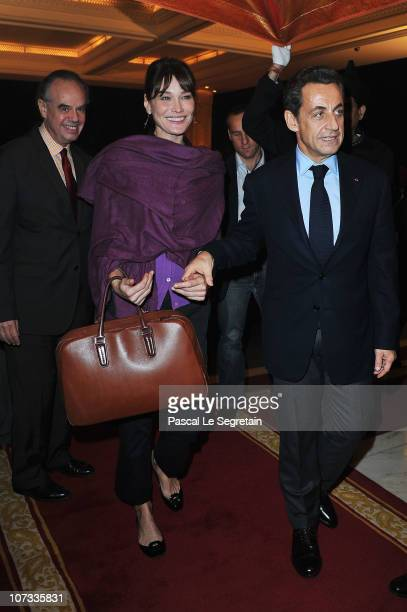 French Culture Minister Frederic Mitterrand French first lady Carla BruniSarkozy and French President Nicolas Sarkozy arrive at the Taj Mahal Palace...