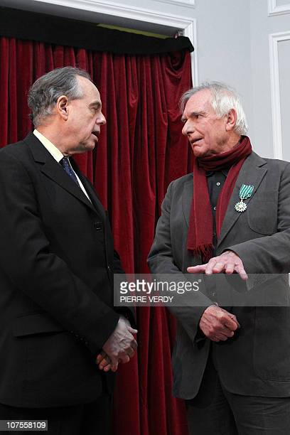 French Culture minister Frederic Mitterrand listens to Australian film director Peter Weir after he awarded him as officer des Arts et Lettres on...