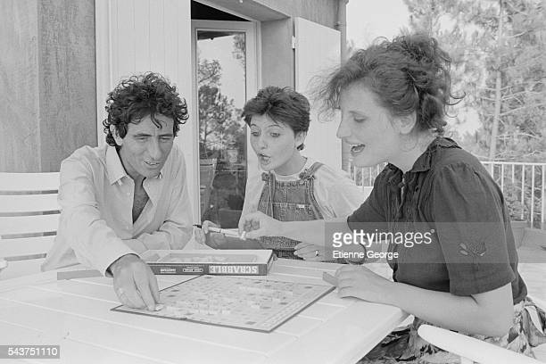 French Culture Minister Jack Lang and his two daughters Valerie and Caroline playing Scrabble during their summer holidays
