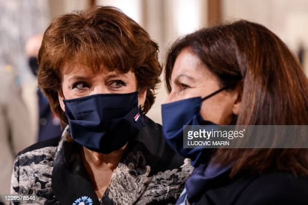 French Culture Minister Roselyne Bachelot and Paris Mayor Anne Hidalgo talk inside the Pantheon monument, prior to a ceremony honouring the World War...