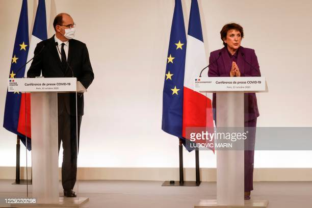 French Culture Minister Roselyne Bachelot delivers a speech next to French Prime Minister Jean Castex during a press conference, at the Hotel...